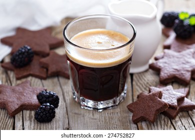 Coffee in a glass with whole wheat chocolate cookies