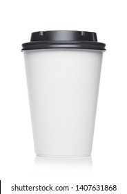Coffee to go in a disposable cup with grey plastic lid on a white