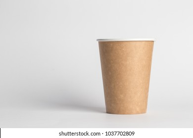 coffee to go in a disposable cup on a white background, place for text