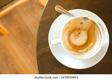 Coffee is gone, white coffee mugs that have been eaten are placed on the table.