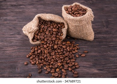 Coffee grains in bags against a dark background