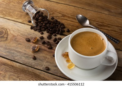 Coffee grains and cup of coffee. Morning coffee concept.