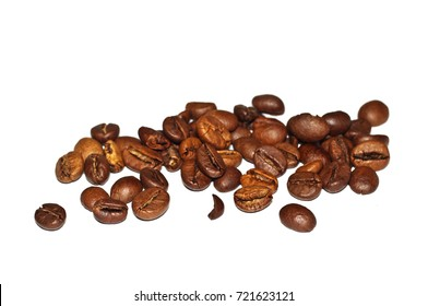 Coffee Grains fried on a white background. Macro