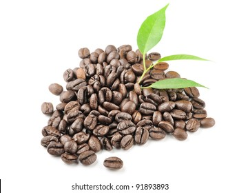 coffee grains and leaves isolated on white