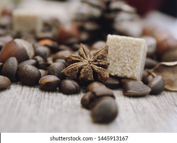 Coffee grains and sugar on the table, coffee set.