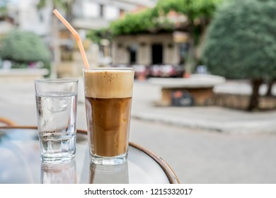 Coffee in Greek Street cafe on a sunny summer day