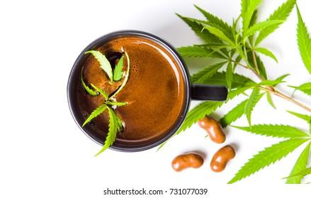 Coffee with green marijuana leaf top view
