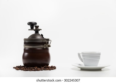 Coffee grinder with bean and coffee cup isolate on white in studio