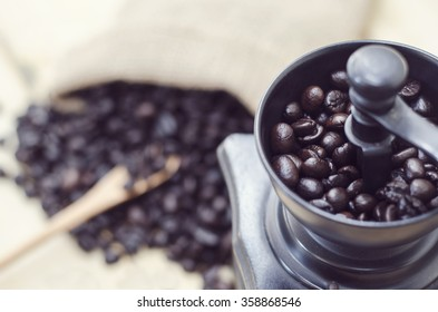 coffee grinder and coffee bean with vintage color