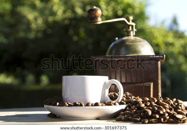 coffee grinder with coffee and coffee beans