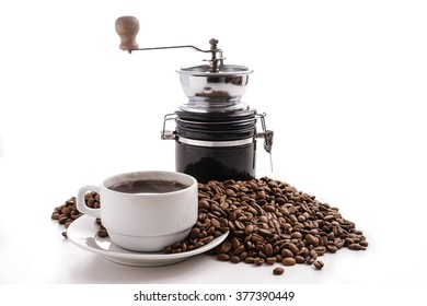 coffee grinder with coffee cup and coffee beans, isolated