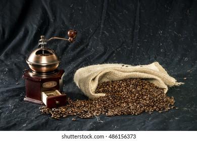 coffee grinder, tots of coffee beans in a jute bag