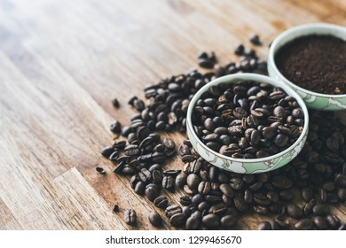 coffee grounds and beans on the wooden table with nobody