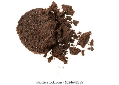 coffee grounds from the coffee machine on White