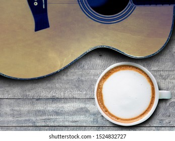 coffee and guitar on wooden table. (with free space for text)