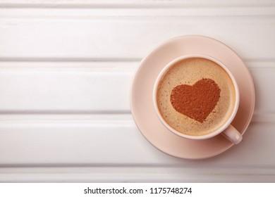 Сup of coffee with heart on foam. I like morning coffee