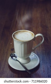 coffee hot drink on wood table , favor drink on wood background