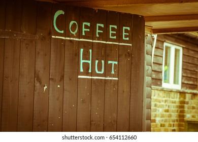 Coffee Hut Written on Wooden Door