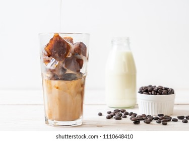 coffee ice cubes with milk on wood table