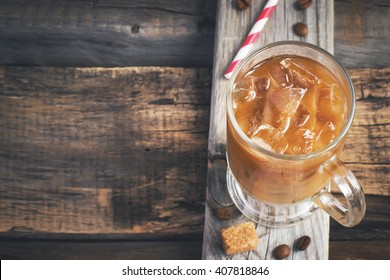Coffee with ice in a glass, selective focus, top view, space for text, tinted