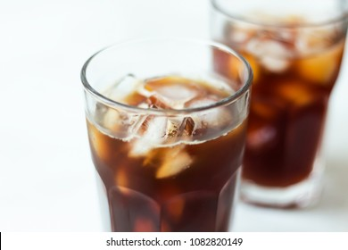 Coffee with ice on light background. Cold brew close up