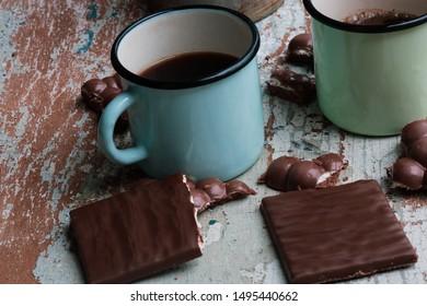 coffee in iron mugs and broken chocolate