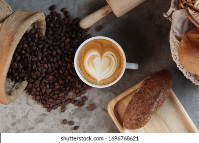 Coffee latte art in cafe and bread