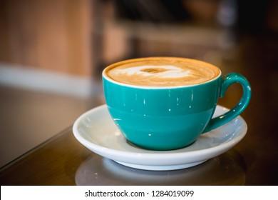 coffee latte art espresso in coffee shop vintage color tone,soft focus