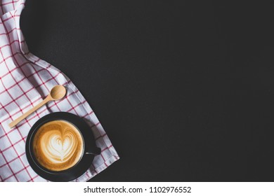 coffee latte art with heart shape on black stone background , flat lay with copy space for your text