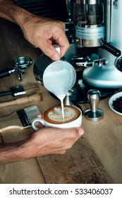 Coffee latte art make by barista in coffee shop