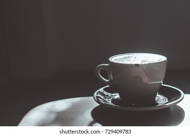 Coffee latte art with notebook on the wood background