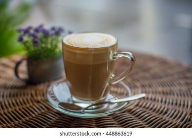 coffee latte art on the desk in coffee shop cafe
