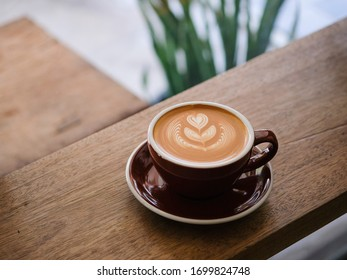coffee latte art on wooden table