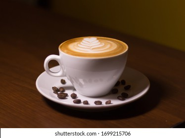 Coffee Latte Art In White Coffee
