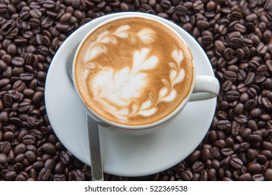 Coffee Latte and Coffee beans on wooden table