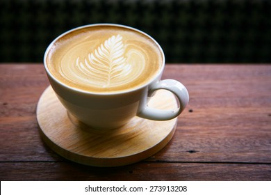 coffee latte / Cup of cappuccino. /hot milk art coffee on wooden table Photo in old image style.