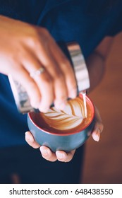 Coffee latte making by coffee master