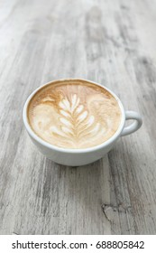 Coffee latte on the old white table , latte art in Chiang Mai, Thailand