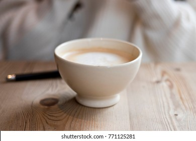 Coffee latte on a wooden table for breakfast.