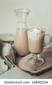 Coffee latte with thick foam and grated chocolate in glass. Vintage toned.