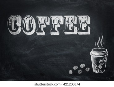 Coffee lettering chalk on black school board background. Cup of coffee. Coffee beans.
