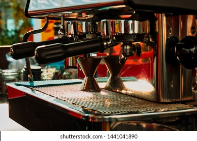 Coffee machine with chrome parts in tavern close-up