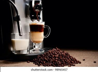Coffee machine milk glass and beans heap