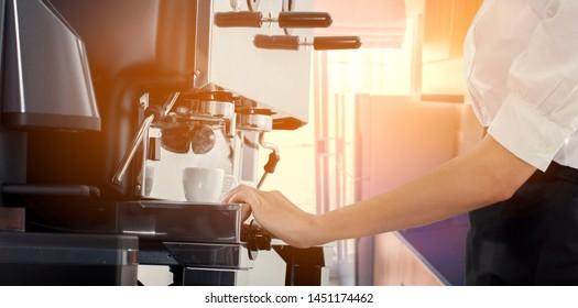 Coffee machine pours fresh espresso into the cups