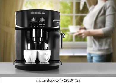coffee machine woman in gray color and window