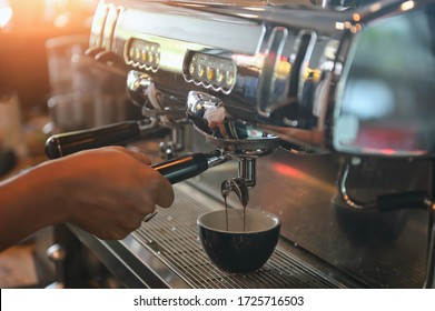 coffee machine,Coffee machine in steam, barista preparing coffee at cafe - Shutterstock ID 1725716503