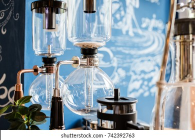 coffee make concept with Drip brewing, filtered coffee or pour-over is a method which involves pouring hot water over roasted bean coffee , ground coffee beans contained in a filter old tradition