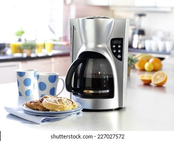 COFFEE MAKER IN KITCHEN