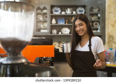 Coffee maker with staff being used. Employees working with coffee makers.