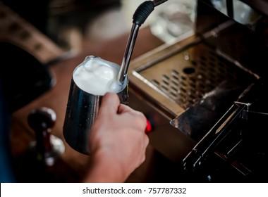 Coffee maker steam the milk for make latte art